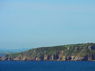 Perched precariously on the cliffs to the east of Trewavas Head are the two engine houses that form the remains of Wheal Trewavas mine.