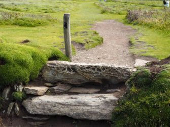 Worn stone stile