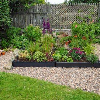 Hopefully edging plants will soften the border, if not I shall try planting something along the outside edge.