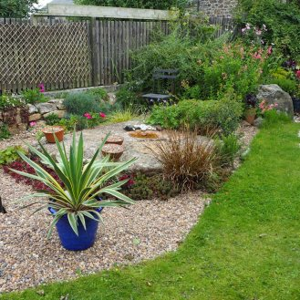 New larger area of gravel with new Yucca in pot. I might plant the Yucca into the gravel